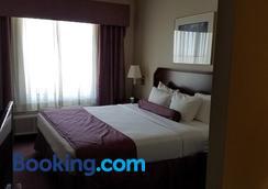 Ashmore Inn & Suites - Amarillo - Bedroom