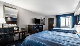 Quality Inn & Suites Downtown - Syracuse - Bedroom