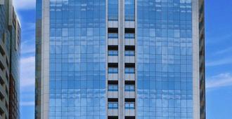 Al Manzel Hotel Apartments - Abu Dhabi - Building