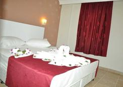 Almila Side Suit Hotel - Side - Bedroom