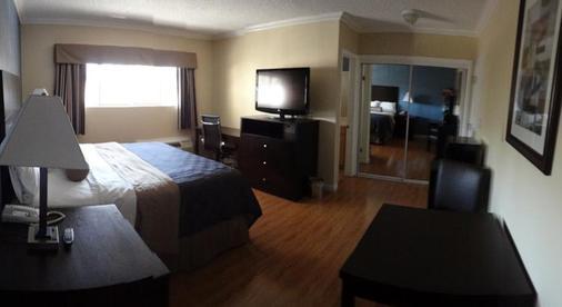 Metropolitan Inn & Suites - Los Angeles - Bedroom