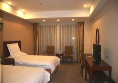 Greentree Inn Jiangsu Wuxi New District Airport Business Hotel - Wuxi - Bedroom