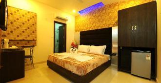 Hotel Pearl Inn & Suites - Amritsar - Bedroom