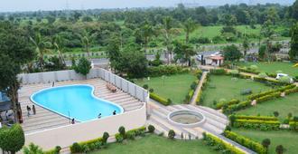 Hotel Sunrise N Resorts - Nagpur - Bedroom