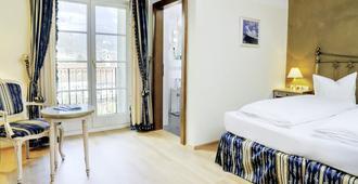 Hotel Schwarzer Adler - Innsbruck - Bedroom