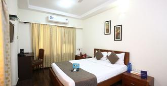 Mint Domestic Airport Suites - Mumbai - Bedroom