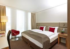 H4 Hotel München Messe - Munich - Bedroom