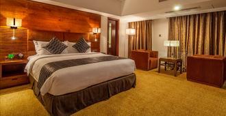 Long Beach Suites Dhaka - Dhaka - Bedroom