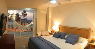 Hotel Tamacá Beach Resort By Sercotel - Santa Marta - Bedroom