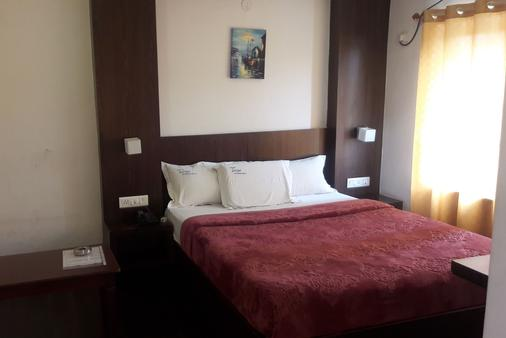 Hotel Luciya International - Mysore - Bedroom