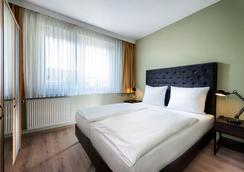 Days Inn Leipzig City Centre - Leipzig - Bedroom