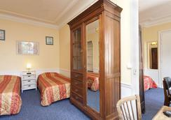 Pension Residence Du Palais - Paris - Bedroom