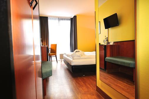 Achat Comfort Airport & Messe Stuttgart (Form. Golden Leaf) - Stuttgart - Bedroom