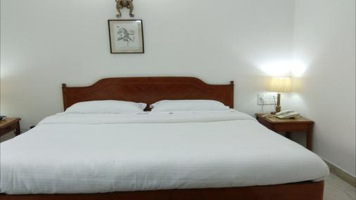 Hotel Palm Greens - New Delhi - Bedroom